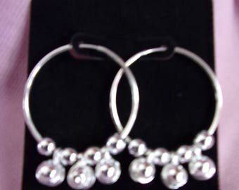 Silver hoops with beads and clapperless bells