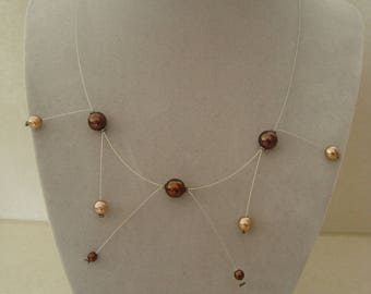 Fine and original necklace in brown tones