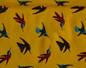 Bird on mustard yellow motifs printed viscose fabric