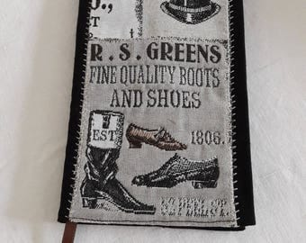 "Cover cloth ""boots and shoes"" on a beige background, back and lining in black thick cotton, with book 11 x 17 cm"