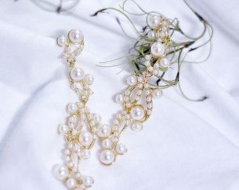 Ipaniel's Pi A Pat Pearl Wave earrings