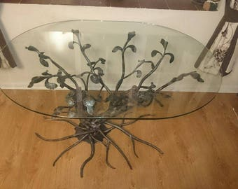Unique oval wrought iron table