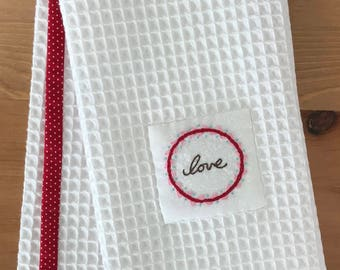 "Handmade hand towel with ""Love"" wreath motif hand-embroidered by Apples N' Thyme"