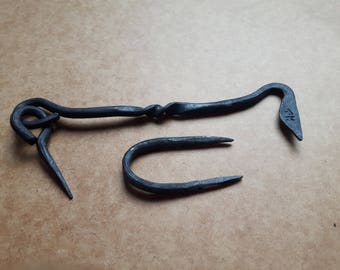 Hand forged traditional style door latch with a twist
