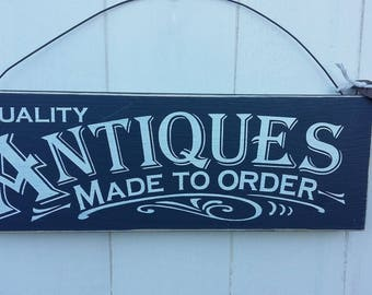 Antiques made to order wooden sign.