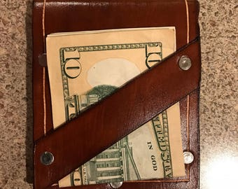 Leather wallet with money clip strip