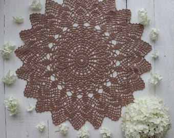Crocheted doily with an openwork pattern
