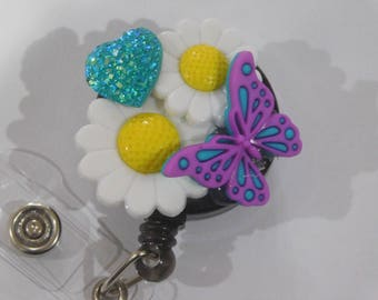 Butterfly and daisy badge reel