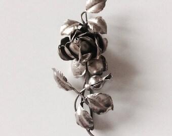 Antique silver carved rose