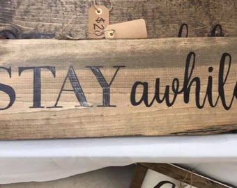 """Farmhouse Rustic """"Stay Awhile"""" sign"""