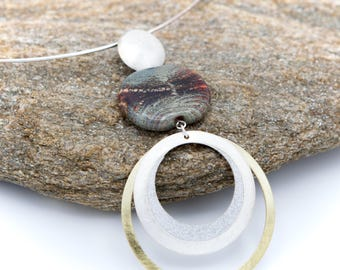 Crew neck color Murano glass bead stone and orange.