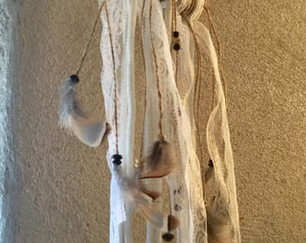 Wall hanging with feathers and Driftwood