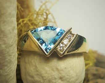 14 Karat Yellow Gold Blue Topaz & Diamond Ring