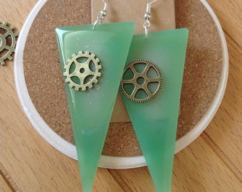 Green triangle earrings in resin with gears.