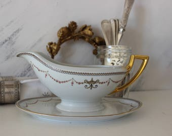 Old porcelain sauceboat,porcelain sauce server