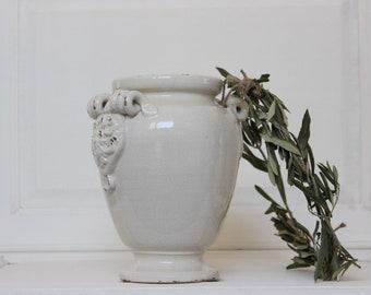Stoneware pot.Sandstone vase.White earthenware.