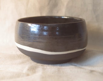 Black on black medium soup bowl. Made from white stoneware and finished in black satin and matt glazes with a natural stoneware streak