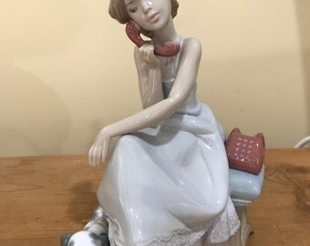 Girl on the phone with the dog LLADRO