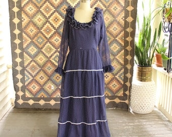 "vintage 1960s 70s maxi dress . blue polka dot dress with ruffled collar, tiered skirt, sheer long sleeves . womens size large 32"" waist"