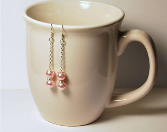 "Rosaline pearl and white crystal 2"" dangles, Swarovski 6mm round faux pearls, 5mm white round crystal accent, .925 sterling silver fishhooks"
