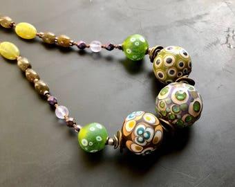Handmade artisan blown glass bead statement necklace Boho, tribal plum, green, turquoise and bronze lampwork glass designer jewelry