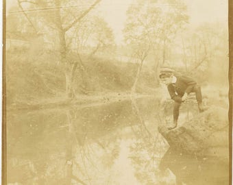 vintage photo 1910 Young Boy Leans Over Rock Looks at REflection in WAter
