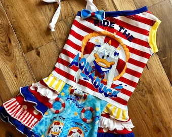 Disney cruise aquaduck ruffle dress ready to ship size 5/6 7/8 donald waterpark one shoulder . Coverup too