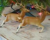 Pair of retro, vintage celluloid reindeer / midcentury Christmas decorations / celluloid running reindeer
