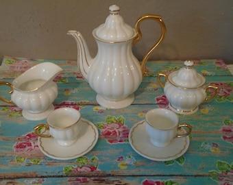 Vintage midcentury diminutive child's china tea set / service for 2 , white china with gold childs tea set. 1950s era play tea set for kids