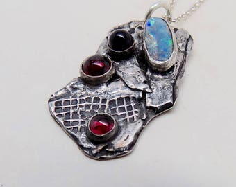 Sterling silver necklace with garnets ,amethyst,and opal gemstones.