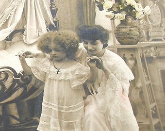 1900s French postcard, Mother & daughter in bedroom.  RPPC, real photo postcard, paper ephemera.