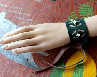 Green leather cuff bracelet with snake vertebrae bones, paint and leather tie-on straps