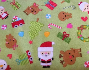 Santa Express Cotton Flannel Fabric in Green