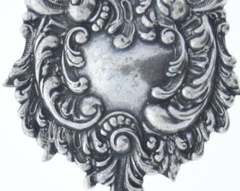 Brass stamping and silver antiqued , victorian motif ,  sold by each 04201CS