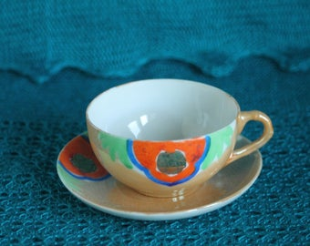 Pearlized Gold and Orange Tea Cup and Saucer