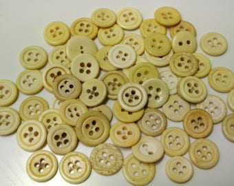 Lot of 60 vintage 1940s used new-washed light yellow natural bone buttons for your sewing prodject