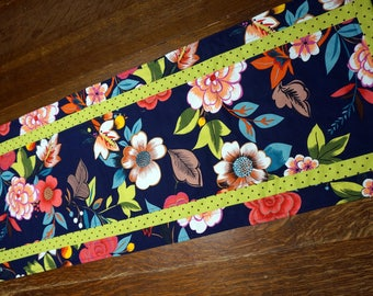 Floral Table Runner Reverses to Halloween Candy and Pumpkins on Black