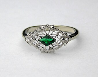 10kt Edwardian Ring with stimulated emerald.