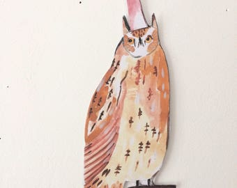 Print on card of a long eared owl in a hat