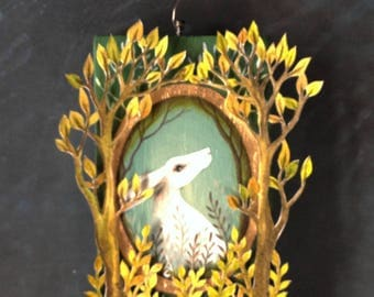 A block painting called The Lost Hare' by Amanda Clark. Acrylic painting with paper cut design.