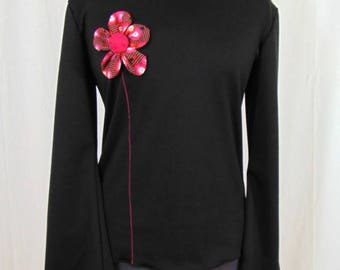 Black sweater and flower