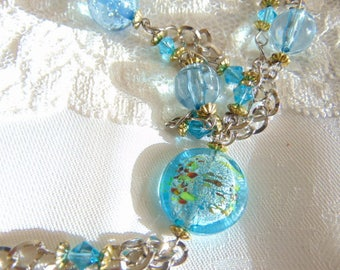 Pretty silver tone and blue glass necklace with dangle 32 inches
