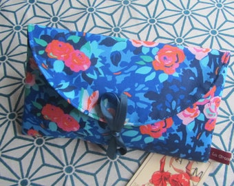 Put checkbook blue designer fabric lined fuchsia leatherette