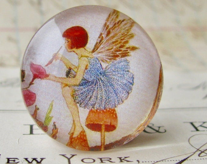Fairy painting the flowers, handmade 25mm round glass cabochon, fantasy stories, bottle cap, 1 inch, from our Winged Wonders collection