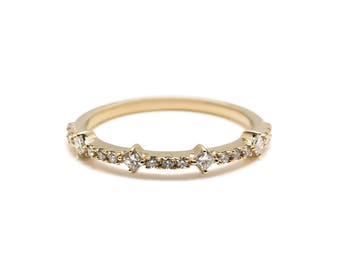Emily Ring - A band of princess cut and round diamonds