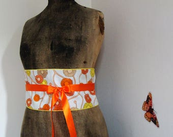 OBI belt has orange and yellow flowers