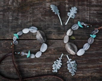 Stardust turquoise birds - smoke fired ceramic necklace 27.6 inches long