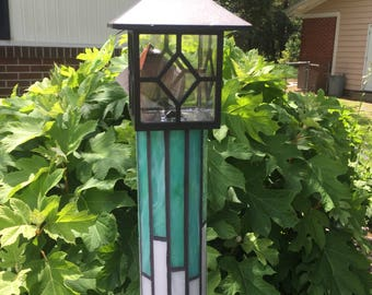 Stained glass totem pole with solar light