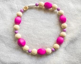 Girly Silicone Teether - Babywearing Teether - Silicone Teething Toy - Baby Clip Teether - Rainbow Baby Gift