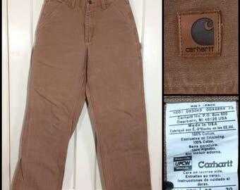 faded brown Carhartt Carpenter Work Pants Heavy Duty Canvas Duck size 30x30, measures 29x29 made in USA